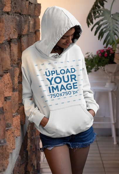 Mockup of a Joyful Woman Wearing a Customizable Pullover Hoodie 33750