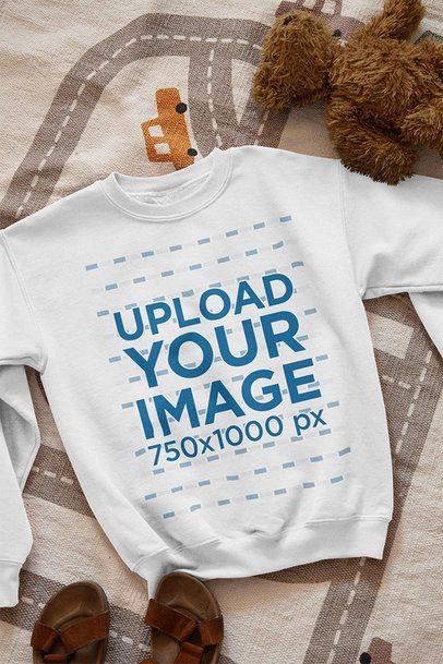 Mockup of a Sweatshirt Lying on a Children's Bedroom Floor 33994