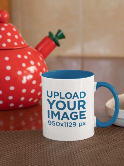 Mockup of an 11 oz Mug With a Colored Rim Placed by a Decorated Tea Pot 33822