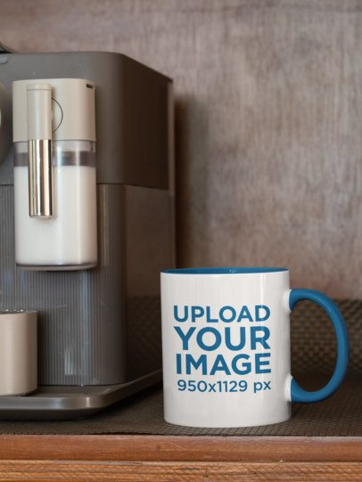 Mockup of an 11 oz Coffee Mug With a Colored Rim Placed Next to an Espresso Machine 33823