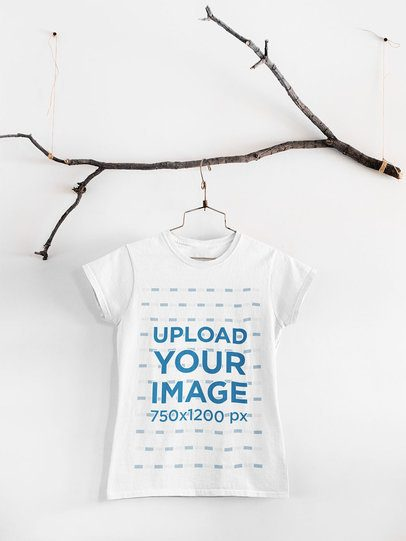 Mockup of a Basic T-Shirt Hanging From an Ornamental Tree Branch 33731