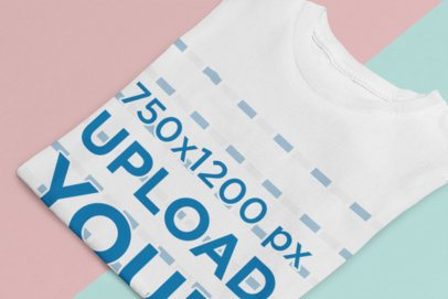 Mockup of a Folded T-Shirt on a Two-Color Surface 33926