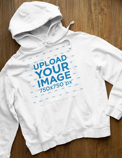Simple Mockup of a Hoodie Placed on a Wooden Surface 33878