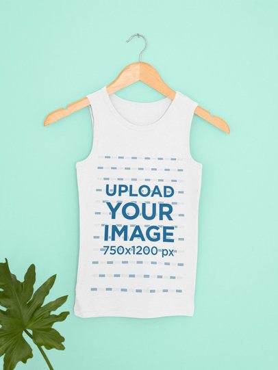 Mockup Featuring a Customizable Tank Top Hanging by a Green Leaf 33844
