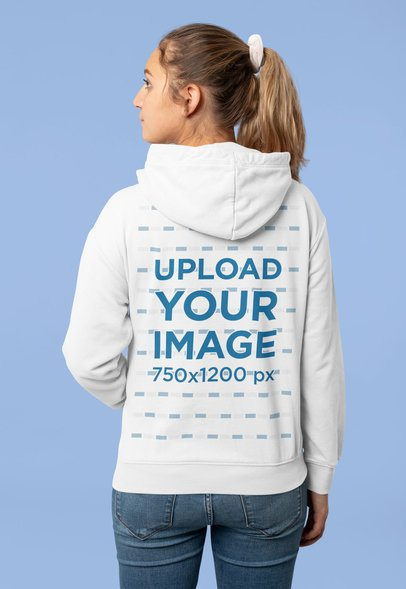 Mockup of a Woman with a Ponytail Wearing a Hoodie at a Studio 31995
