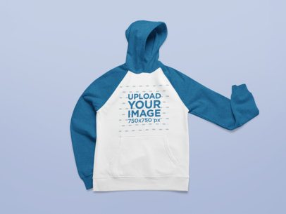 Mockup of a Raglan Hoodie Placed on a Plain Surface 25309