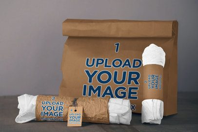 T-Shirt Packaging Mockup Featuring a Paper Bag and a Brand Tag 4027-el1