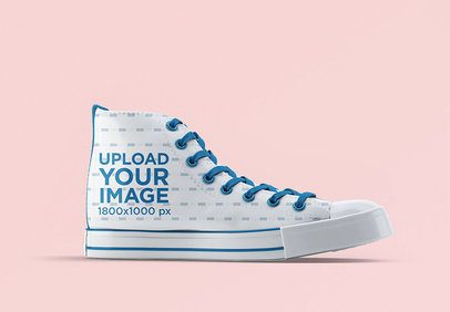 Shoe Mockup Featuring a Single Sneaker Against a Solid Color Backdrop 3266-el1