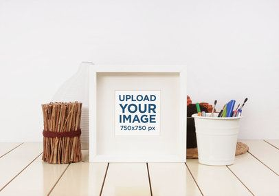 Mockup Featuring a Small Framed Art Print 3954-el1