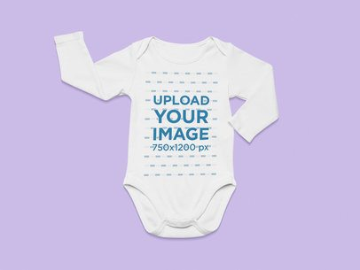 Flat Lay Mockup of a Long-Sleeve Onesie on a Flat Surface 25513