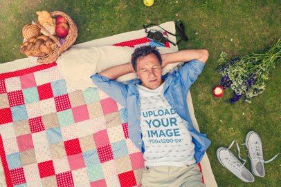 T-Shirt Mockup of a Man Lying on a Picnic Blanket 34091-r-el2