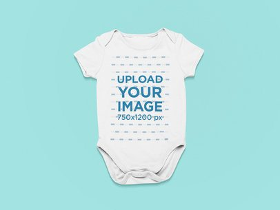 Mockup of a Round Neck Onesie Against a Customizable Background 25515