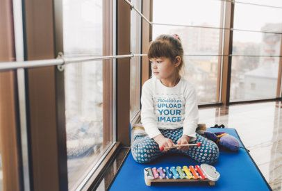 Mockup of a Little Girl with a Long-Sleeve Tee Playing with a Xylophone 34257-r-el2