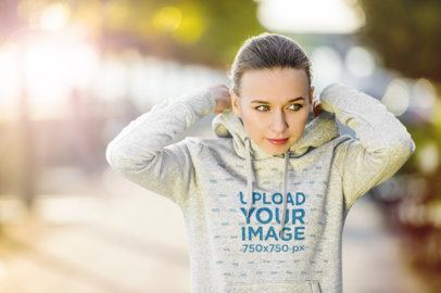 Mockup of a Female Jogger Wearing a Heathered Pullover Hoodie 34077-r-el2
