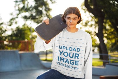 Mockup of a Youngster with a Sweatshirt Holding a Skateboard 34032-r-el2