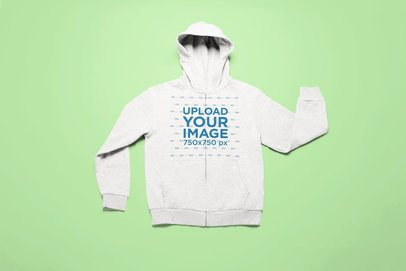Front-View Mockup of a Full-Zip Hoodie on a Flat Surface 25722