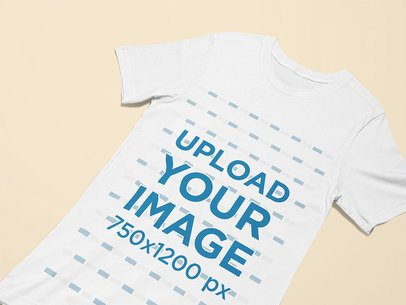 Closeup Mockup of a T-Shirt Laid on a Customizable Surface 25628