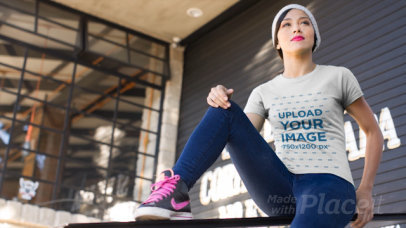 T-Shirt Video of a Woman with Urban Look Sitting Outside a Restaurant 12827