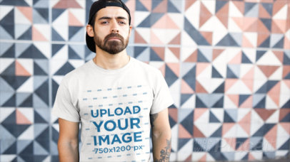 T-Shirt Video of a Serious Man with Tattoos Posing by a Wall with Patterns 12170