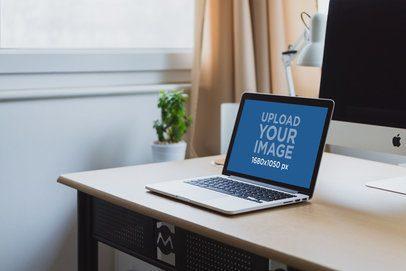 Mockup of a MacBook on a Desk with a Bigger Screen 3808-el1