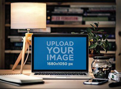 Mockup of a MacBook in a Cozy Home Office 3815-el1