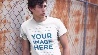 Round Neck Tee Video Mockup of a Handsome Young Man Leaning on a Fence a12138