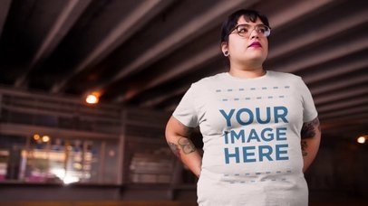 Plus Size Young Woman with Glasses Out in the City Wearing a Round Neck Tee Mockup Video a12650