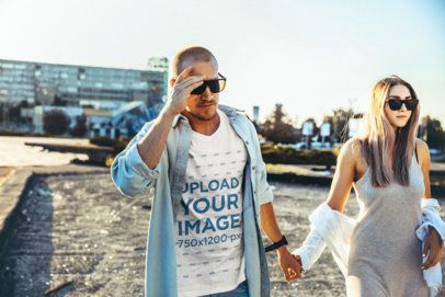 T-Shirt Mockup of a Man and His Girlfriend Walking by a Park 34325-r-el2