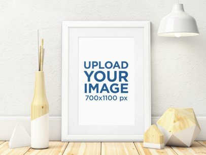 Mockup of an Art Print Placed on a Wooden Surface by Minimal Decorative Items 3968-el1