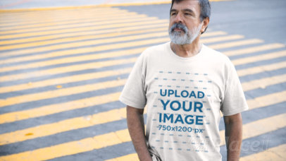 T-Shirt Video of a Senior Man Standing on the Street 12763