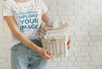 T-Shirt Mockup of a Woman Holding a Basket of Clean Towels 34417-r-el2