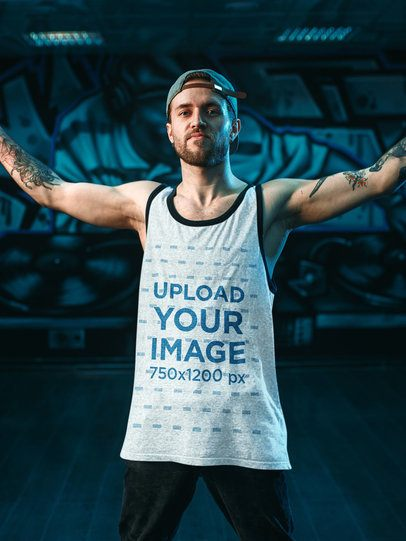 Mockup of a Man with a Heather Tank Top Posing by a Graffiti Wall 34639-r-el2
