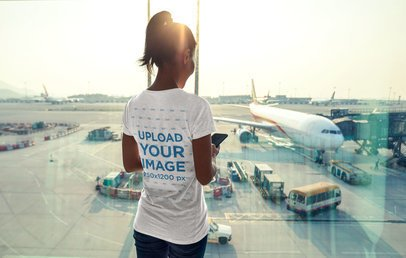 Back View Mockup of a Woman Wearing a T-Shirt at the Airport 34560-r-el2