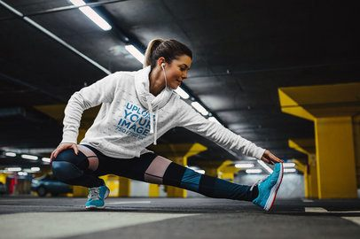 Mockup of a Woman Stretching in a Heathered Hoodie 34289-r-el2