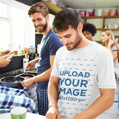 Tee Mockup of a Man Making Breakfast at the Kitchen with His Friends 34248-r-el2