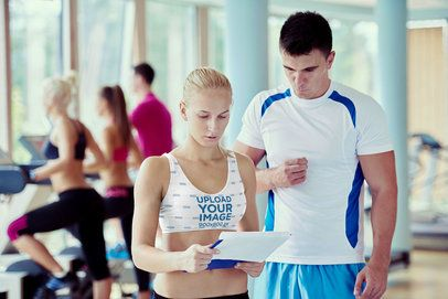 Sports Bra Mockup Featuring a Woman Talking to Her Gym Trainer 34412-r-el2