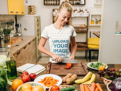 Mockup of a Happy Woman with a T-Shirt Cooking in the Kitchen 34695-r-el2