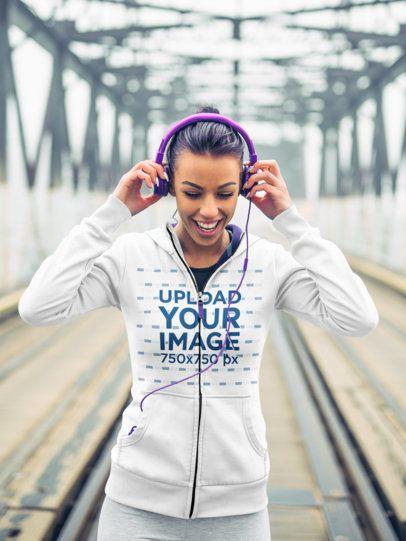 Mockup of a Jogger with Headphones Wearing a Full-Zip Hoodie 34177-r-el2