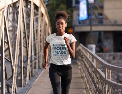 T-Shirt Mockup of a Woman Jogging in an Urban Setting 34445-r-el2