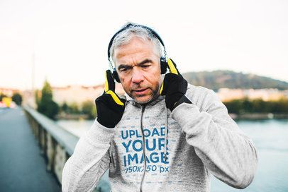 Heathered Full-Zip Hoodie Mockup of a Man Listening to Music While Jogging 34286-r-el2