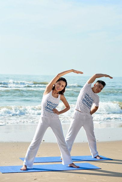 Mockup of a Couple Doing Yoga at the Beach with a Tank Top and a Tee 34230-r-el2
