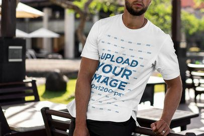 Cropped Face Mockup of a Man with a T-Shirt Leaning on a Chair 4343-el1