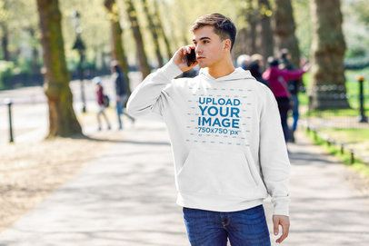 Pullover Hoodie Mockup of a Man Talking on the Phone at a Park 34170-r-el2