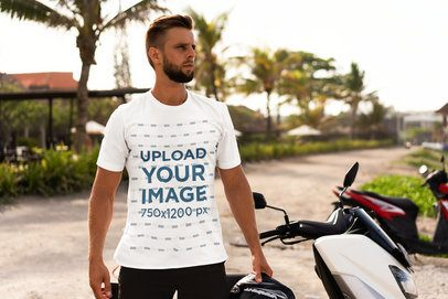T-Shirt Mockup Featuring a Bearded Man with a Motorcycle on the Beach 4347-el1