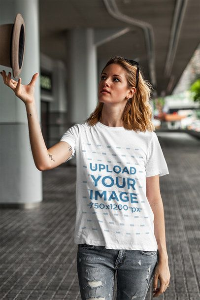 T-Shirt Mockup of a Young Woman Playing with a Hat 4324-el1