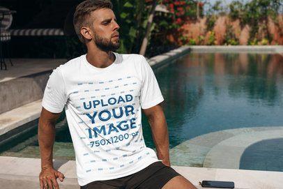 T-Shirt Mockup of a Bearded Man Sitting by a Pool 4348-el1