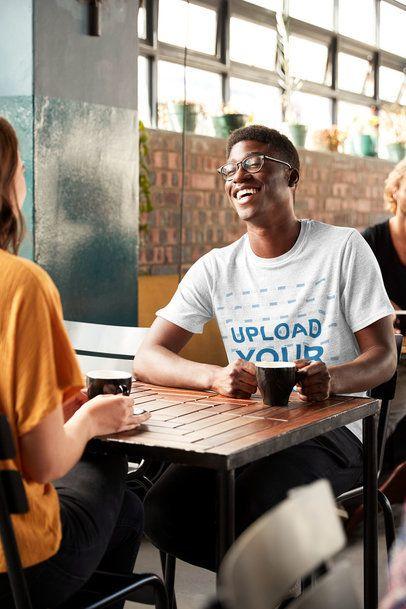 T-Shirt Mockup of a Happy Young Man Talking to a Friend at a Restaurant 34548-r-el2