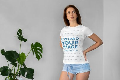 T-Shirt Mockup Featuring a Woman Posing Next to an Indoor Plant 4289-el1