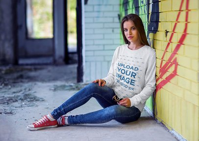 Crewneck Sweatshirt Mockup of a Woman Sitting Against a Graffiti Wall 4353-el1