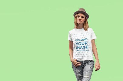 Basic T-Shirt Mockup of a Woman Posing Against a Customizable Background 4328-el1
